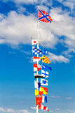 Flags on flagpole Stock Images