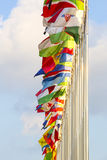 Flags on flagpoles. Different countries flags on flagpoles on the sky background Royalty Free Stock Photos