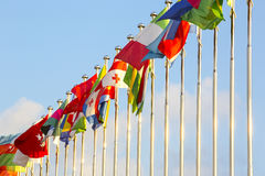 Flags on flagpoles. Different countries flags on flagpoles on the sky background Stock Photo