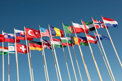 Flags on flagpoles fluttering in the wind. Flags of different countries on flagpoles fluttering in the wind Royalty Free Stock Photography