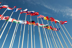 Flags on flagpoles fluttering in the wind Royalty Free Stock Images
