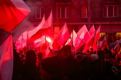 Independence Day March in Warsaw Poland Marred by Violence and Controversy. Flags and flares can be seen being waved by protesters at the annual Polish Royalty Free Stock Images