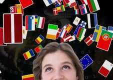 Flags flaying over the woman head. earth back. Digital composite of flags flaying over the woman head. earth back Royalty Free Stock Photography
