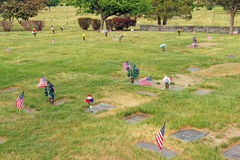 Flags and flowers in cemetery Memorial Day Stock Images