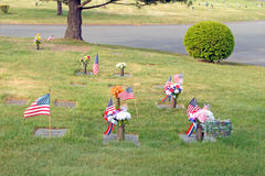 Flags and flowers in cemetery Memorial Day Royalty Free Stock Photos