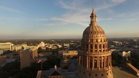 Flags Fly Dusk Austin Texas Capital Building Motion. Aerial view of the capital building near dusk at Austin Texas stock video footage