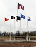 Flags fly at Fields of Honor. OSHKOSH, WI - APRIL 10: The flags fly at the Fields of Honor Military Veterans Museum. The museum has just completed phase one of Royalty Free Stock Photography