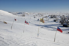Flags fly at Oceti Sakowin Camp with turtle hill in background, Cannon Ball, North Dakota, USA, January 2017 Stock Images