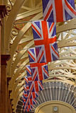 Flags Flying. BARNSTAPLE, ENGLAND - APRIL 18: Union Jack flags adorn the Victorian pannier market hall in Barnstaple, England on April 18, 2011 in advance of Royalty Free Stock Photography
