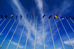 Flags flying in the breeze Stock Photo