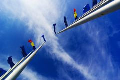 Flags flying in the breeze royalty free stock images