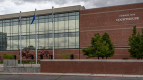 Flags flying at the Carson City Courthouse. The Carson City Courthouse in Nevada Stock Photography