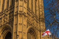 Flags flying over parliament square London stock image