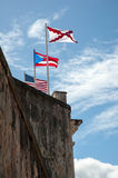 Flags on Fort Wall. Flags of the United States of American, Puerto Rico and Spain positioned above the fort wall of El Morro in Old San Juan Royalty Free Stock Photos