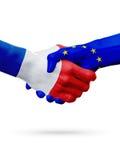 Flags France, European Union countries, partnership friendship handshake concept. Stock Image