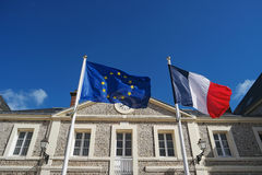 Flags of France and European Union waving in wind Royalty Free Stock Photos