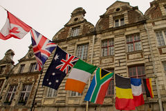 Flags in front of Arras Building Royalty Free Stock Photos