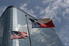 Flags in front of the office building. Texas and USA flags in front of the office building in TX Stock Image