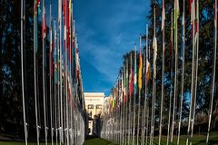 Flags in front of the United Nations building in Geneva Switzerland stock photos