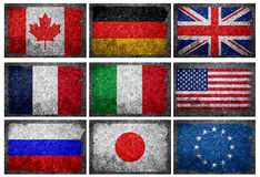 Flags of the G8 Industrialized Countries and EU on Wall. Grunge flags of the G8 Industrialized Countries and European Union painted on concrete. EU is Stock Photography