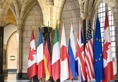 Flags of the G8 Countries. In a gothic architectural setting royalty free stock image
