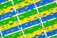 Rain drops full of Gabon flags royalty free stock images