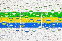 Water drops on glass and flags of Gabon Royalty Free Stock Photo