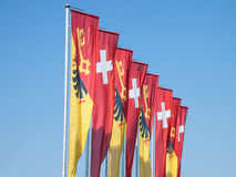 Flags of Geneva and Switzerland waiving in the wind in Geneva, one of the economyc and financial hubs of the country. Picture of Geneva and Swiss flags during a stock images