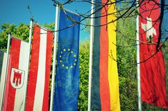 Flags of German-speaking countries in front a park royalty free stock image