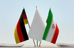 Flags of Germany and Iran. Desktop flags of Germany and Iran with white flag in the middle stock images