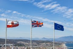 Flags of Gibraltar, UK and EU flying in Gibraltar stock image