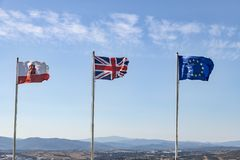The flags of Gibraltar, UK and the EU flying in Gibraltar stock photo