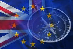 Flags of Great Britain of European Union. Closeup image of retro compass against overlapped flags of Great Britain of European Union vector illustration
