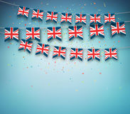 Flags of Great Britain, United Kingdom. Garland with British banners. Colorful flags of Great Britain, United Kingdom with confetti on blue background. Festive vector illustration