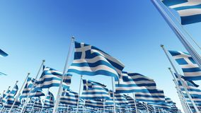 Flags of Greece on flag poles against blue sky. stock video