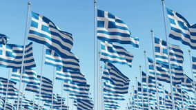 Flags of Greece waving against clear blue sky. stock video footage