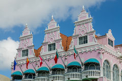 Flags and Green Awnings on Pink Stucco Royalty Free Stock Photography