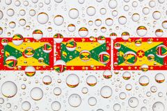 Water drops on glass and flags of Grenada Royalty Free Stock Photography