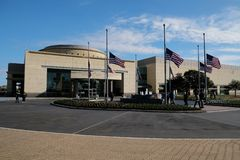 Flags at half mast at the George Bush Presidential Library royalty free stock photos