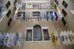 Flags hanging in the historic Mass State House Stock Photo