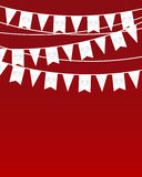 Flags hanging on the ropes. On red background Royalty Free Stock Image