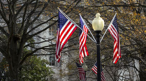 Flags hanging from streetlight Royalty Free Stock Photography