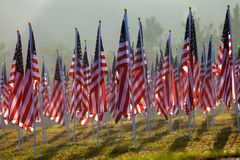 Flags in the Healing Fields for 9/11. Flags set in a row as part of the healing fields for 9/11/2011 in Grand Rapids Michigan. Each flag was designed to Royalty Free Stock Photos
