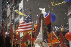 Flags Held Aloft in Ticker Tape Parade, New York City, New York Stock Image