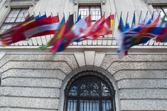 Flags on Hofburg palace in Vienna, Austria. The Imperial Palace Hofburg is the most representative example of Vienna's characteristic variety of architecture Royalty Free Stock Photos