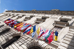 Flags on Hofburg palace in Vienna. The Imperial Palace Hofburg is the most representative example of Vienna's characteristic variety of architecture styles Stock Images