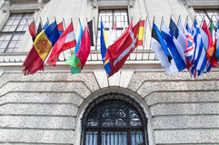 Flags on Hofburg palace in Vienna. The Imperial Palace Hofburg is the most representative example of Vienna's characteristic variety of architecture styles Royalty Free Stock Photos