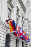 Flags on Hofburg palace in Vienna. The Imperial Palace Hofburg is the most representative example of Vienna's characteristic variety of architecture styles Royalty Free Stock Image