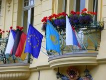 Flags on Hotel Balcony, Karlovy Vary. Flags and flowers on balconies above hotel entrance, Karlovy Vary, Western Bohemia, Czech Republic Royalty Free Stock Photos