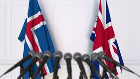 Flags of Iceland and The United Kingdom at international meeting or negotiations press conference. 3D animation stock footage